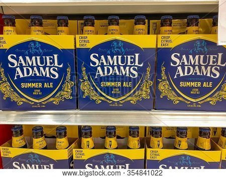 Orlando, Fl/usa-3/7/20: A Display Of Six Pack Of Bottles Of Samuel Adams Summer Ale On A Display She