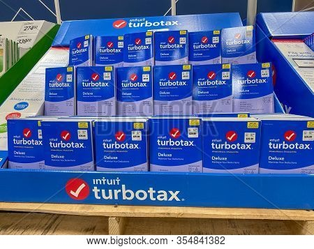Orlando, Fl/usa-3/7/20: A Display Of Intuit Turbotax  Deluxe On A Display Shelf Of A Sams Club Whole