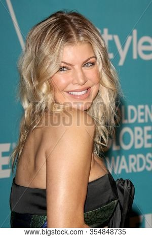 LOS ANGELES - DEC 8:  Fergie aka Stacy Ferguson arrives at the HFPA And InStyle Present
