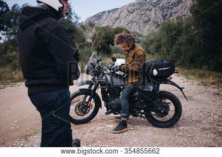 Men Look At Map On Motorcycle Trip