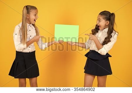 Give It Publicity. Small Kids Pointing Fingers At Blank Poster For School Publicity. Little Children