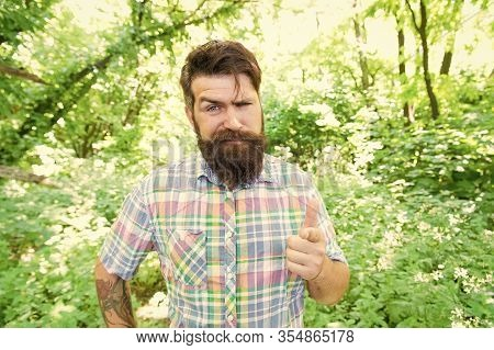 Hey, Look. Bearded Man Pointing Finger Before Him On Natural Landscape. Brutal Hipster Pointing With