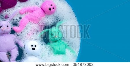 Soaking Rabbit Dolls With Bear Toys In Laundry Detergent Water Dissolution Before Washing. Laundry C