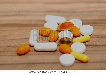 Pills Background.many Colorful Pills On A Brown Wooden Background. Cropped Shot, Horizontal, Side Vi
