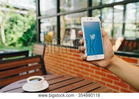 Chiang Mai, Thailand - Feb.17,2020: Man Holding Apple Iphone 8plus With Twitter App.twitter Is An On