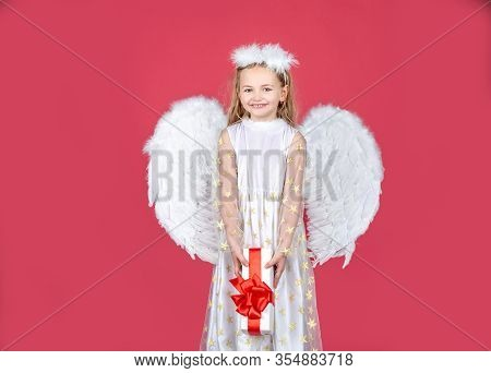 Valentines Day. Angel Child From Heaven Gives You Gift. Little Angel Girl In White Dress With Angel
