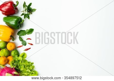 Fresh Fruit And Vegetable. Flat Lay Of Fresh Raw Organic Vegetables On White Background