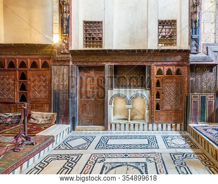 Cairo, Egypt- February 22 2020: Wooden Painted Floral Patterns, Embedded Arched Niche, Wooden Door,
