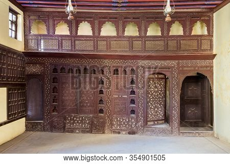 Oriental Wooden Engraved Arabesque Decorations With Balcony Installed Inside Empty Spacious Room