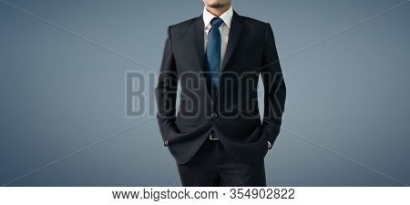 Business Portrait Of Handsome Man In Black Suit