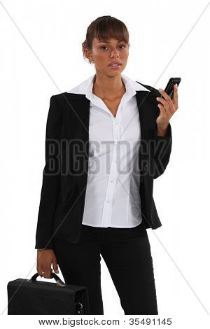A disappointed woman looking up from her mobile phone