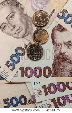 Ukrainian Hryvnia, Several Banknotes Of 1000 And 500 Hryvnias With Coins. Financial Background From