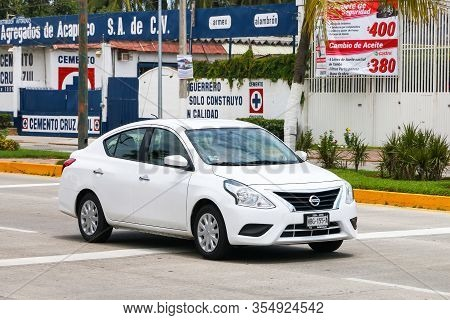Acapulco, Mexico - May 28, 2017: Motor Car Nissan Versa In The City Street.