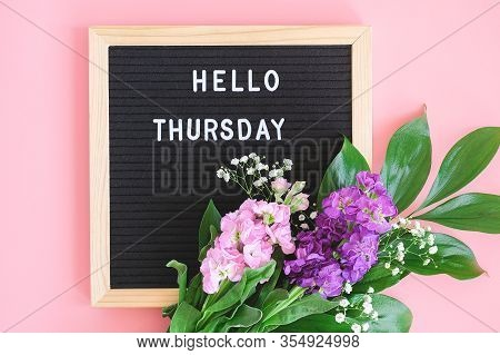 Hello Thursday Text On Black Letter Board And Bouquet Colorful Flowers On Pink Background. Concept H