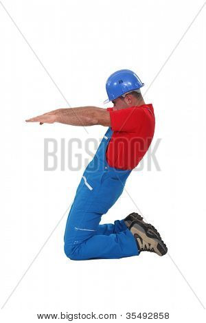 Workers knees with arms outstretched