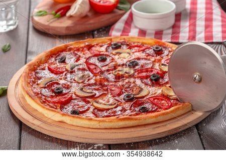 Hot Homemade Pepperoni Pizza Close Up. Creative Photo.
