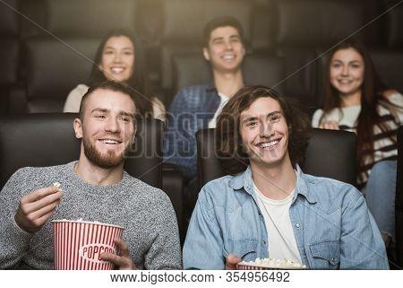 Showtime Concept. Happy Spectators Enjoying Interesting Movie In Cinema