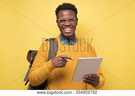 Happy African American College Student Holding Table