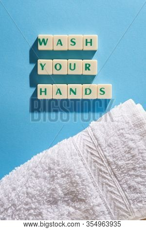 wash your hands word on the square blocks on the blue background