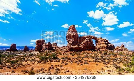 Turret Arch, One Of The Many Large Sandstone Arches In The Desert Landscape Of Arches National Park