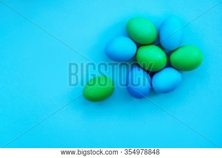 Flatlay With Dyied On Green And Blue Easter Eggs Isolated On Bright Blue Background. Hand Drawn Eggs