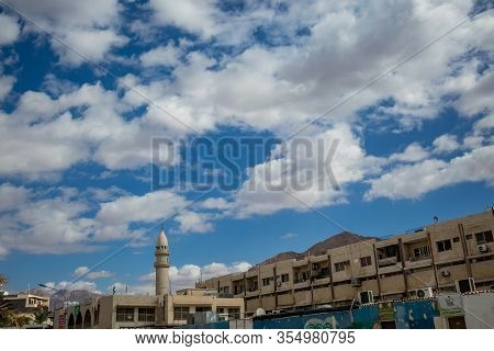 Aqaba, Jordan - January 31, 2020: Beautiful Winter Puffy White Clouds Moving In Sky Over The Famous