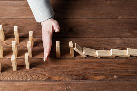 Business Woman Hand Block Domino Effect. Business Risk Management And Stabilisation Situation. Life