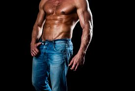 Muscular Model Sports Young Man On Dark Background. Athletic Man With Ab, Abs Or Six Pack. Chest Mus