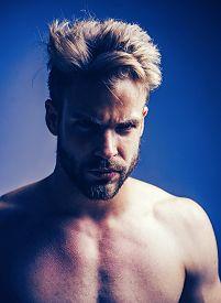 Closeup Man Portrait. Man Face. Handsome Bearded Man - Face Half On Grey Background. Sad And Stress