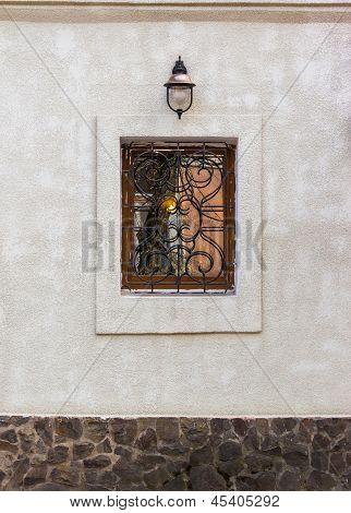 Window With Protection And Lantern