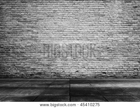 old grunge interior with brick wall, black and white background