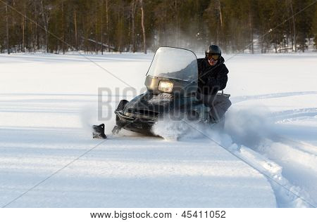 Man Riding A Snowmobile