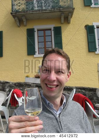 a man enjoying a glass of wine outdoors poster