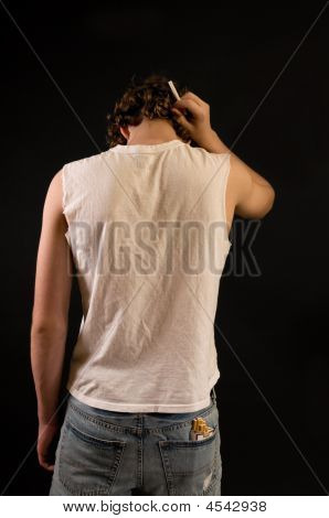 Teenage Boy With Cigarette, Rear View