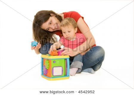 Joyful Young Mother And Baby Playing
