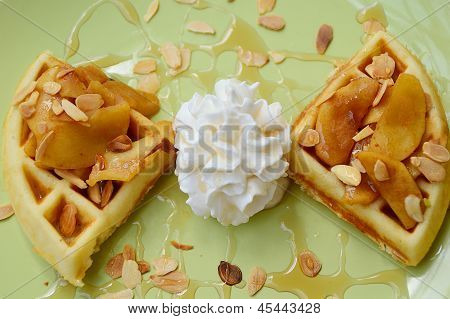 almonds waffle with wipcream and cyrup for breakfast poster