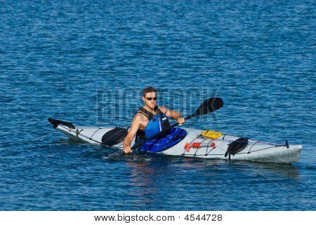 Atheltic Man In A Sea Kayak