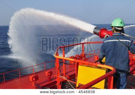 Fireman Testing A Foam/water Gun