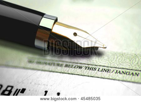 Close up on cheque with an ink pen