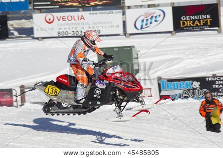 Red And Black Polaris Snowmobile Racing High In Air