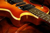 A single cutaway curved maple top heavy duty tock guitar. poster