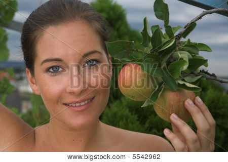 Young Attractive Woman With Apple