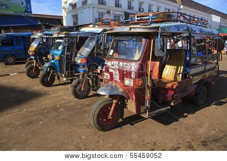 Champasak Laos - Nov23- Group Of Three Wheel Vehicle Queue  In Doawreung Market Pakse City Champasak