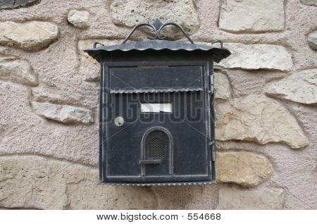 Old Postbox On Stone Wall