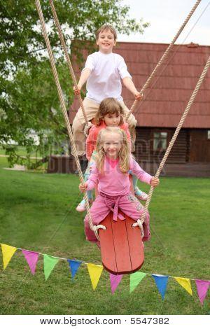 Three Children On Teetering-board