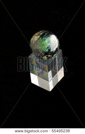 Glass Sphere Ornament Atop Block