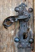 Old Metal Lock And Key On Wooden Door poster