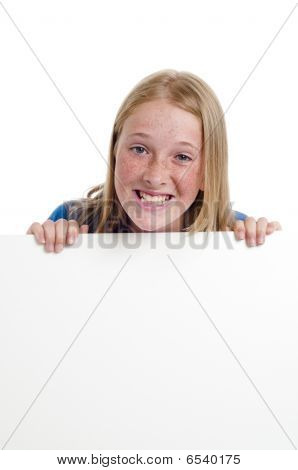 Girl Holding Large Blank Sign Board And Smiling