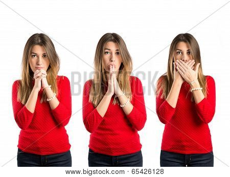 Young Girl Doing Surprise Gesture And Pleading Over Isolated White Background