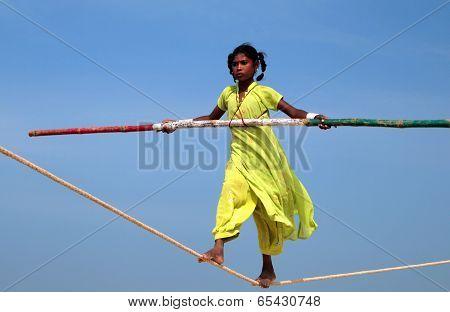 Goa, India - Feb 12: Wandering Indian Tightrope Walker Playing On The Beach Of Goa, On Feb 12, 2008.